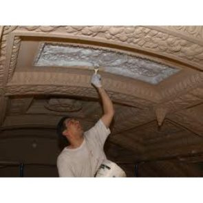 man casting concrete on ceiling for silicone mould